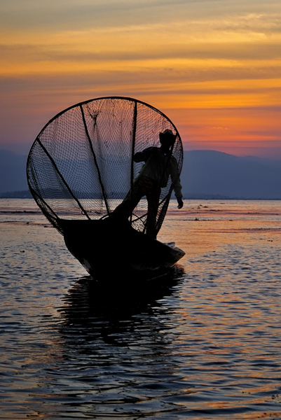 46- Fisherman Framed By Net