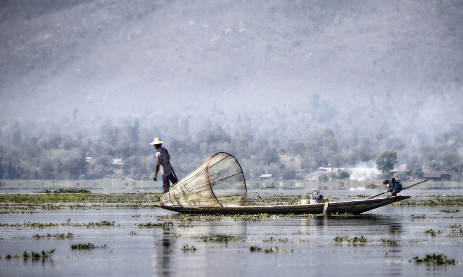 40- Fisherman with Cone Net